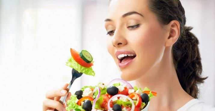 A-Beautiful-Girl-Eating-Healthy-Food-715x403